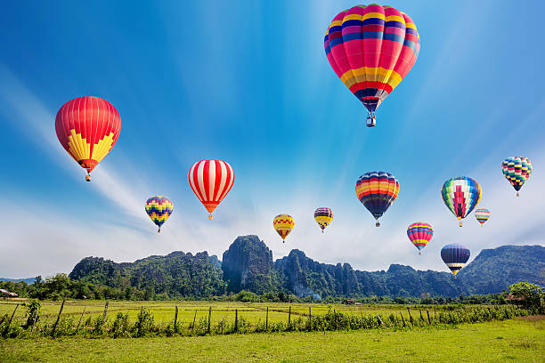 Colourful hot-air balloons flying over the mountain. stock photo
