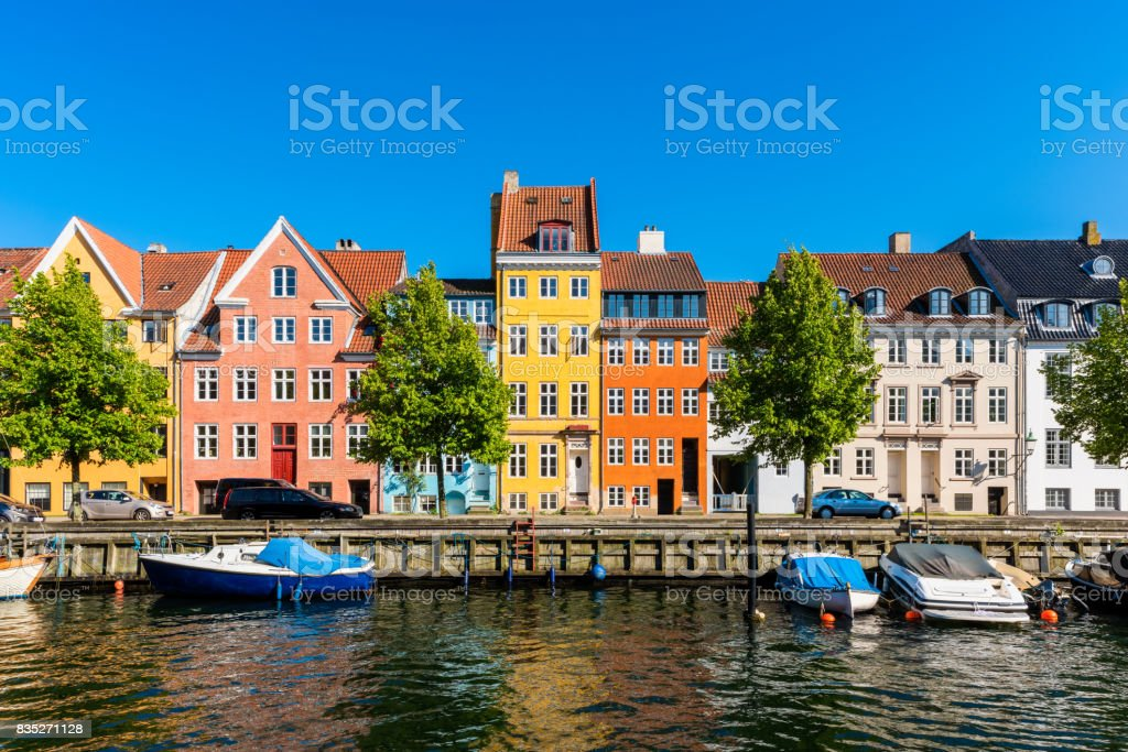 Colourful houses along canal in Copenhagen Denmark stock photo