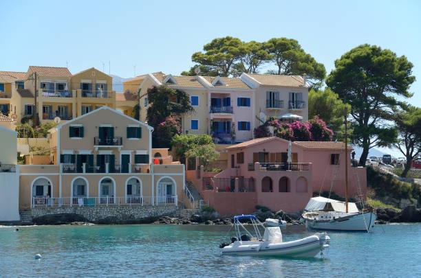 Colourful houses in  Assos marina stock photo