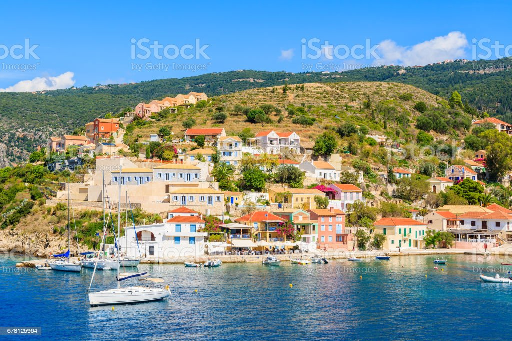 Colourful houses of Assos village and yacht boats in port on Kefalonia island, Greece stock photo