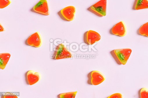istock Colourful Jelly, pizza and heart shape on pastel pink background 908920074