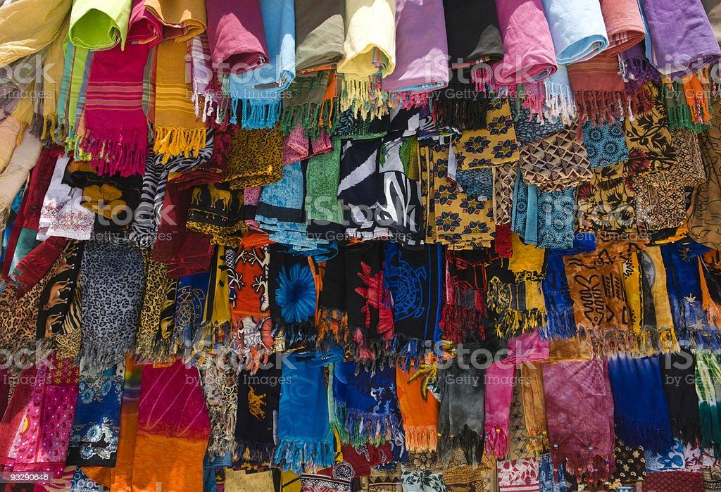 Colourful kangas for Sale on a Kenyan Beach stock photo