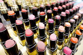 istock Colourful Lipstick in store or shopping Malls. Lipstick tints palette, Professional Makeup and Beauty. Beautiful Make-up concept. Lipgloss. huge assortment of women luxurious lipsticks, free shipping. 1044671970