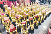 istock Colourful Lipstick in store or shopping Malls. Lipstick tints palette, Professional Makeup and Beauty. Beautiful Make-up concept. Lipgloss. huge assortment of women luxurious lipsticks, free shipping. 1044672544