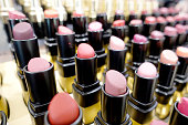 istock Colourful Lipstick in store or shopping Malls. Lipstick tints palette, Professional Makeup and Beauty. Beautiful Make-up concept. Lipgloss. huge assortment of women luxurious lipsticks, free shipping. 1044672584