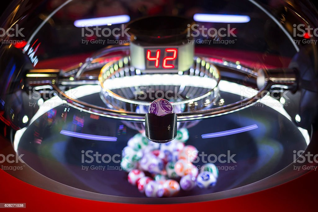 Colourful lottery balls in a lotto machine 42 stock photo