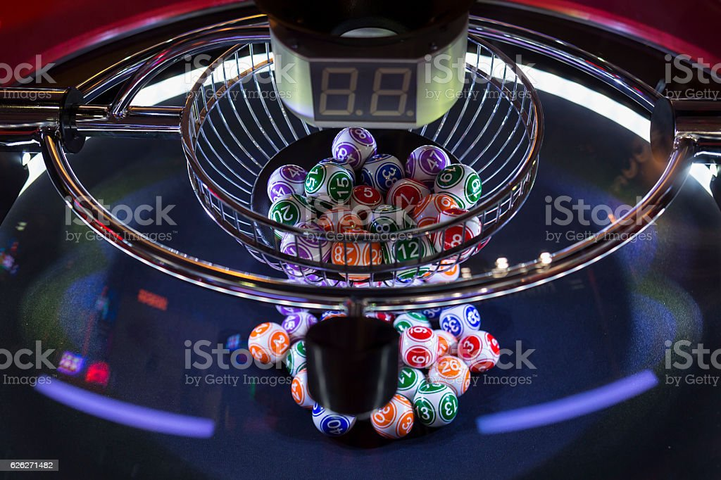 Colourful lottery balls in a lotto machine - Photo