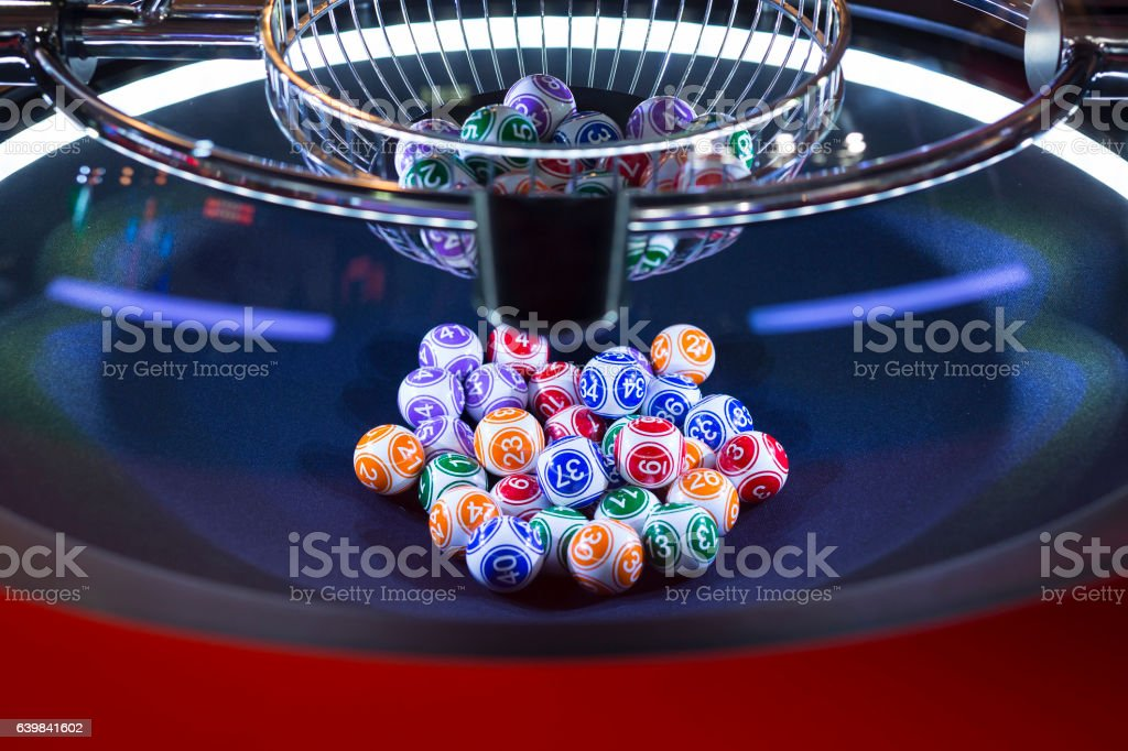 Colourful lottery balls in a machine stock photo