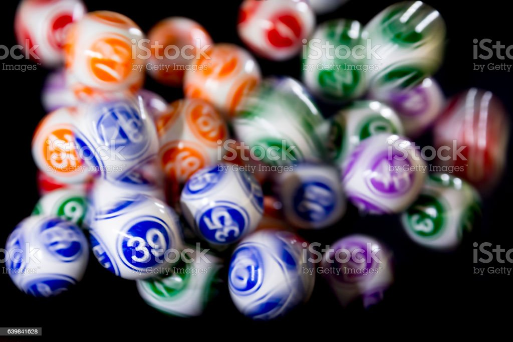 Colourful lottery balls in a machine - Photo