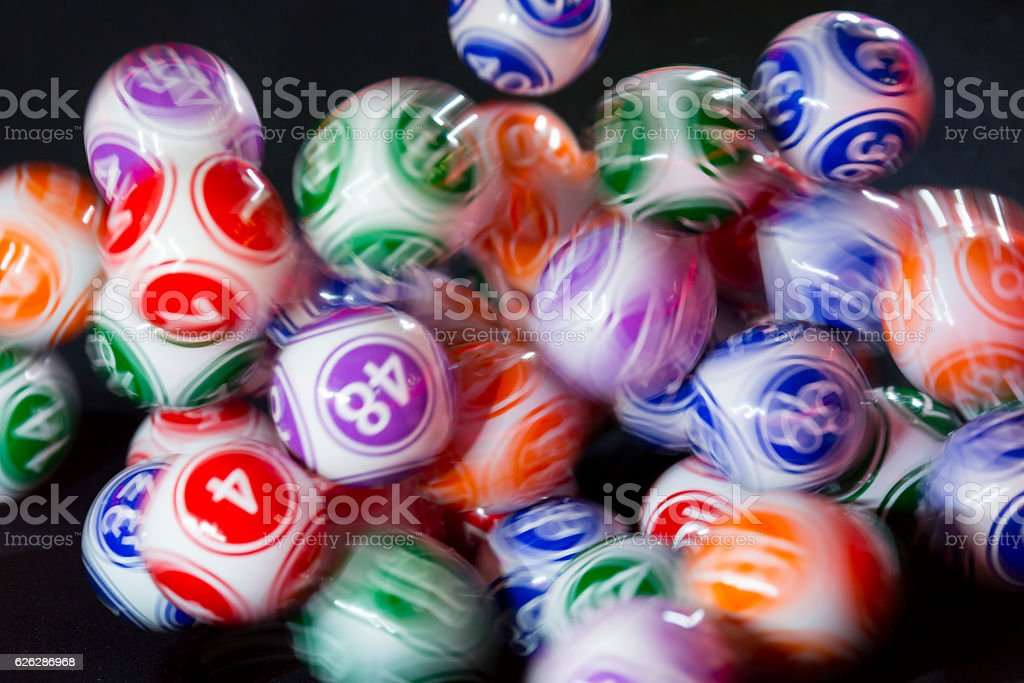 Colourful lottery balls in a sphere - Photo