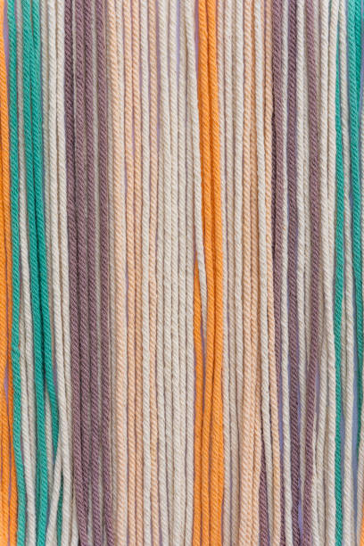Colourful macrame threads texture closeup for background. Vertical Photography. stock photo