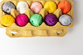 Knitting and crochet - wool and yarn crafts - balls of wool in an egg box