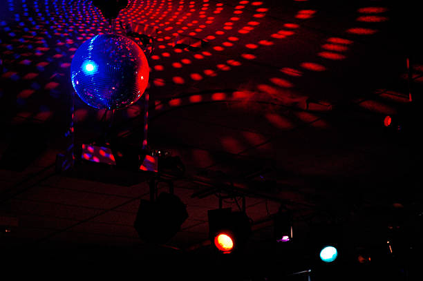 Colourful mirrorball in disco 4 stock photo
