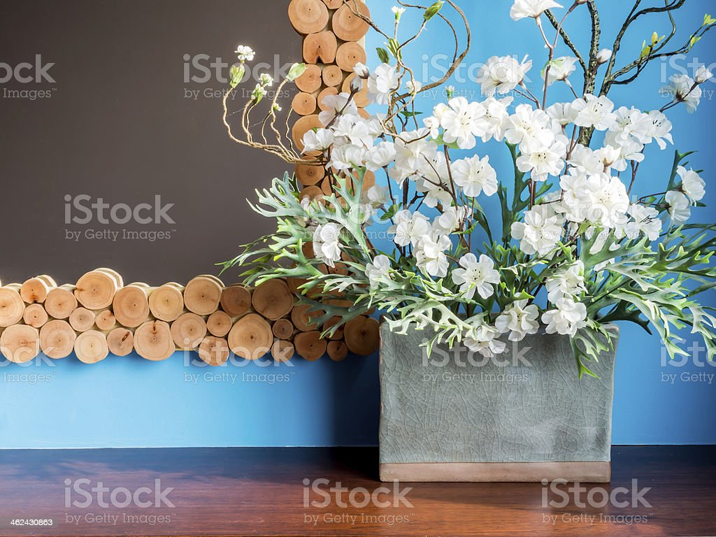 Colourful modern interior wall with artificial flowers in cerami stock photo