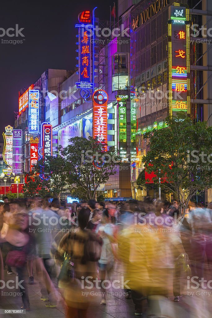 Crowds of Chinese shoppers milling along the pedestrianised plaza of...