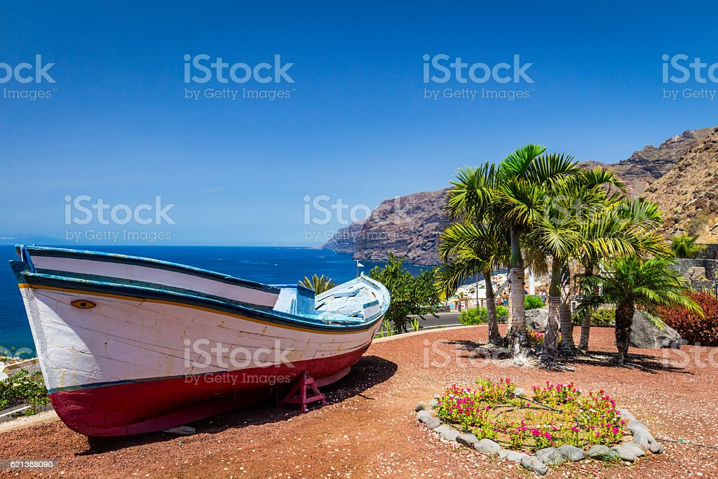 Colourful painted fishing boat near the ocean in Los Gigantes stock photo