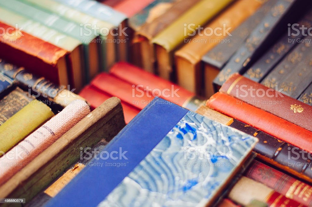 Colourful pile of old books stock photo