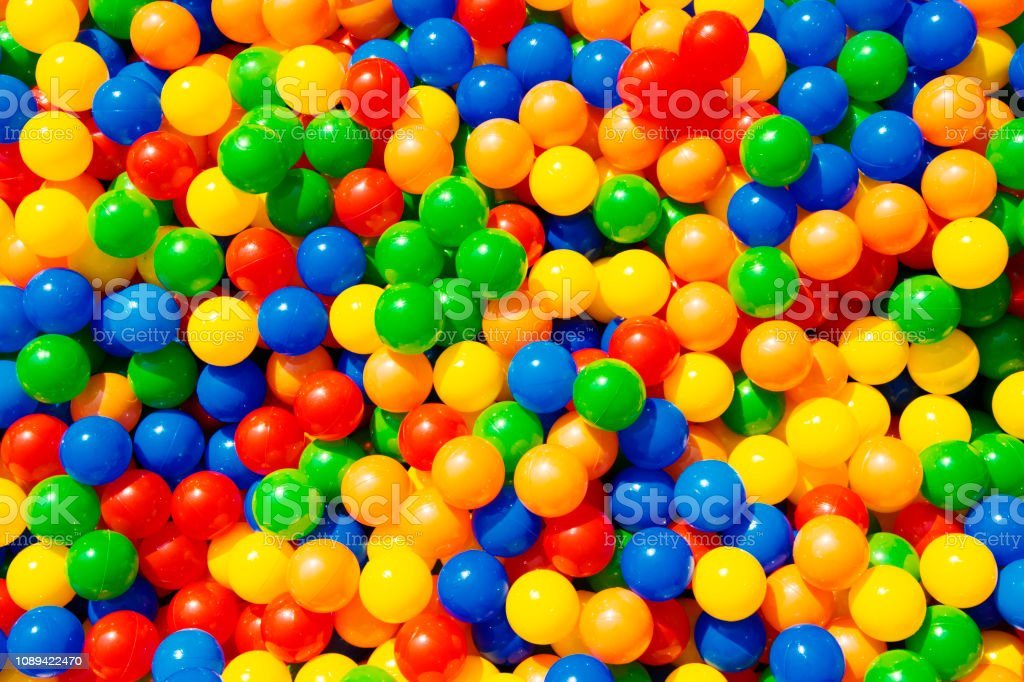 Colourful Plastic Balls in a Ball Pool stock photo