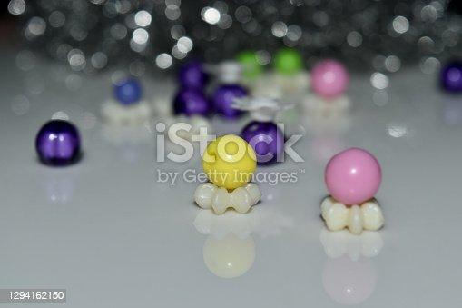 Colourful plastic balls on white surface unique photo