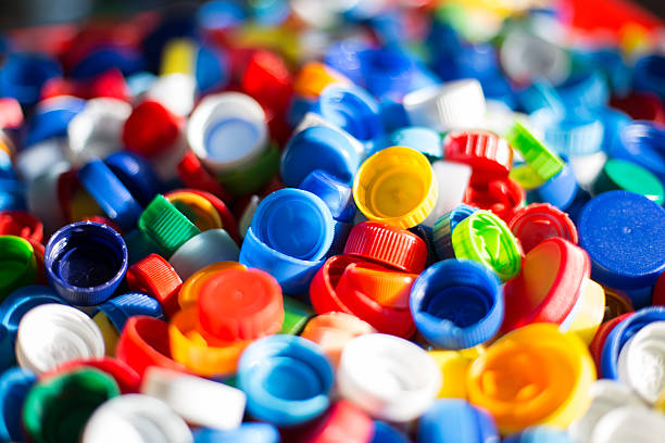 colourful plastic bottle caps - plastic cap stock photos and pictures