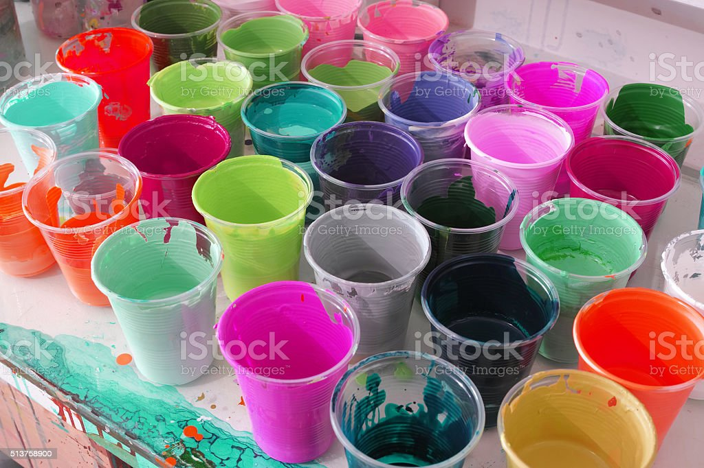 Colourful Plastic Container Full of Paints Ready To Use stock photo