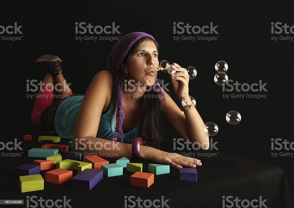 Colourful Retro Hippy Woman Blowing Bubbles royalty-free stock photo