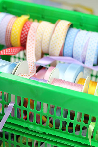 Colourful ribbons placed in a tray stock photo