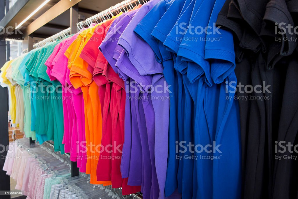 Colourful shirts and clothes on sale in a retail store. royalty-free stock photo
