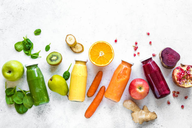 Colourful smoothies and ingredients stock photo
