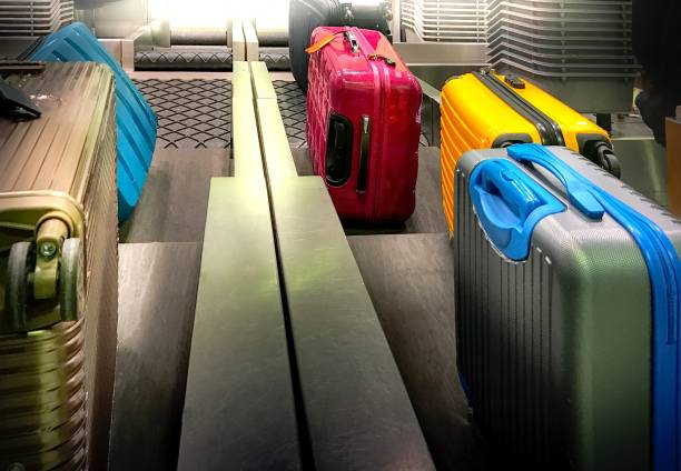 colourful suitcases  are loaded at check-in counter - airport check in counter stock pictures, royalty-free photos & images