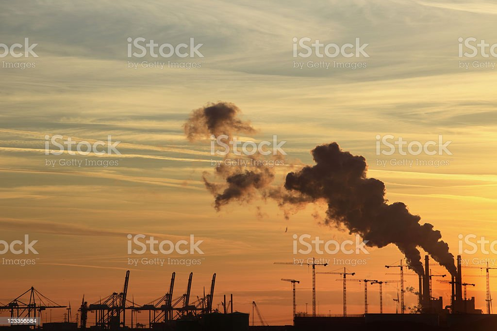 colourful sunset behind an industrial area royalty-free stock photo