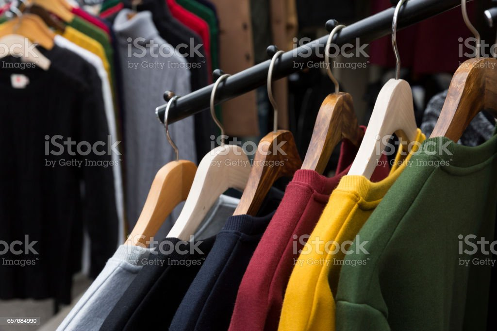 Colourful sweaters on clothes rack – Foto