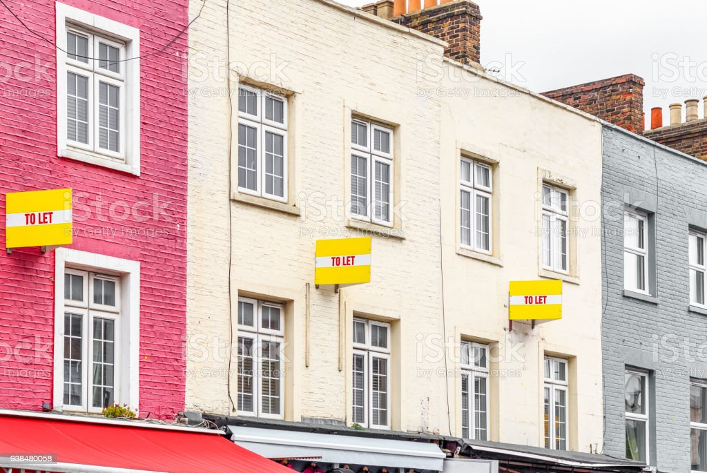 Colourful terraced houses with TO LET signs - Royalty-free Apartment Stock Photo