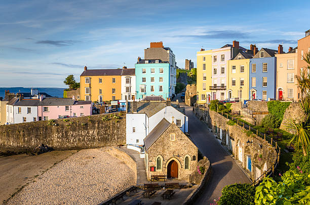 Colourful Town Houses at Sunset Pastel Coloured Town Houses overlooking the Harbour at Sunset. Tenby, Wales, UK. wales stock pictures, royalty-free photos & images