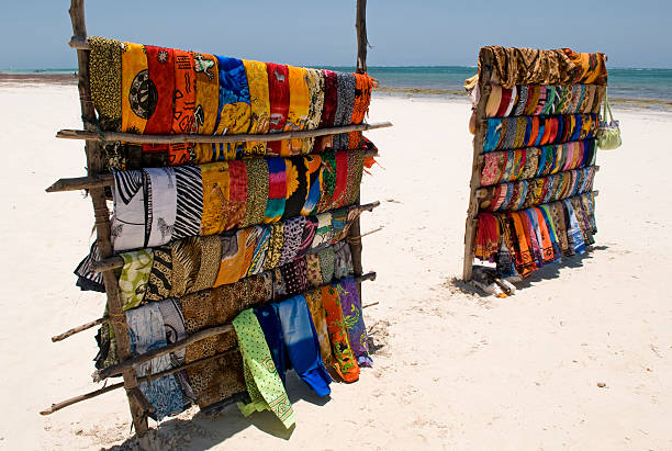 Colourful traditional Kangas for sale on a beach in Kenya stock photo
