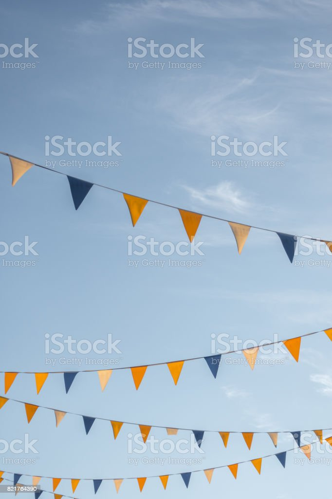 colourful triangle flages on blue sky background stock photo more
