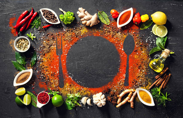 Colourful various herbs and spices for cooking on dark background stock photo