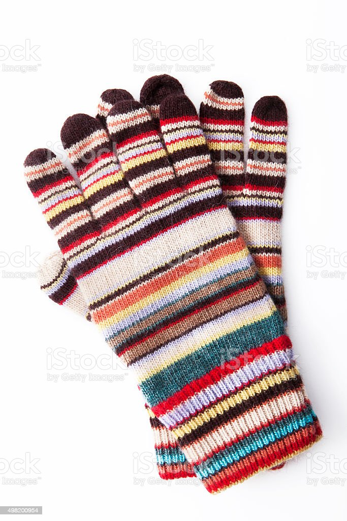 Colourful winter gloves on white background stock photo