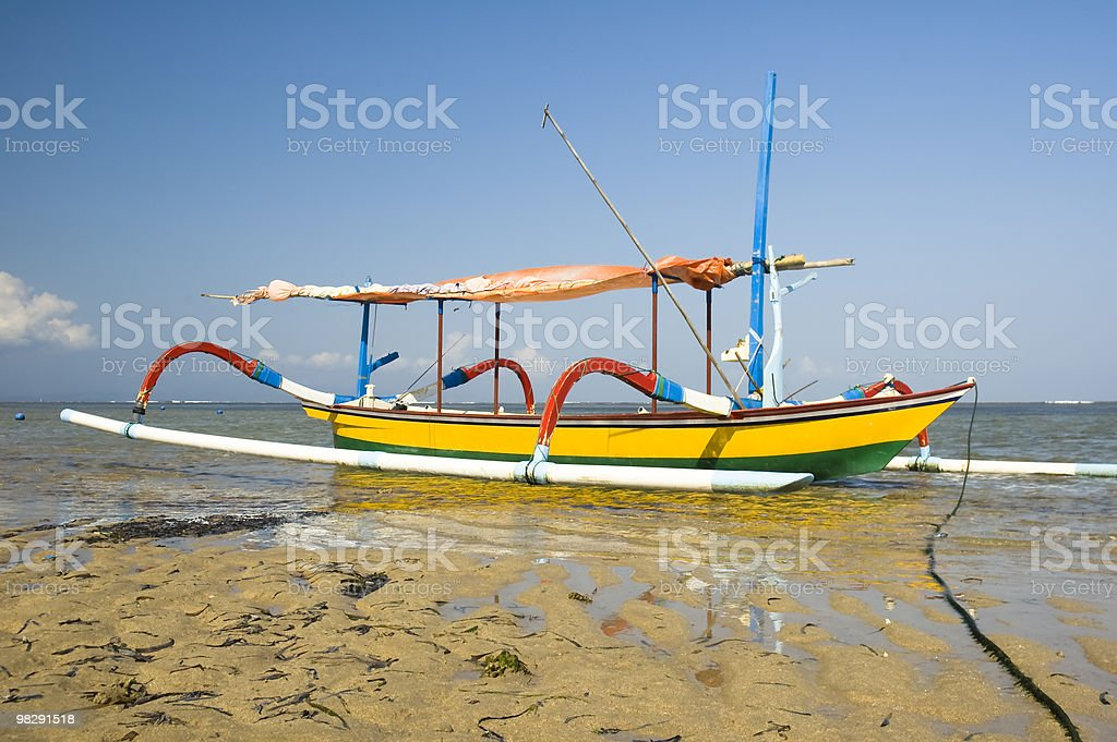 Colourful wooden fishing boat moored at Asian beach royalty-free stock photo