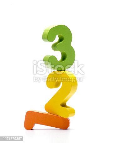 istock Colourful wooden numeric on top of each other on white background 1171775387