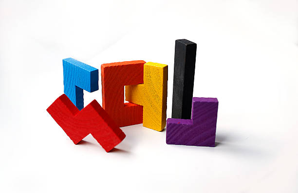 Colourful wooden puzzle blocks on white background