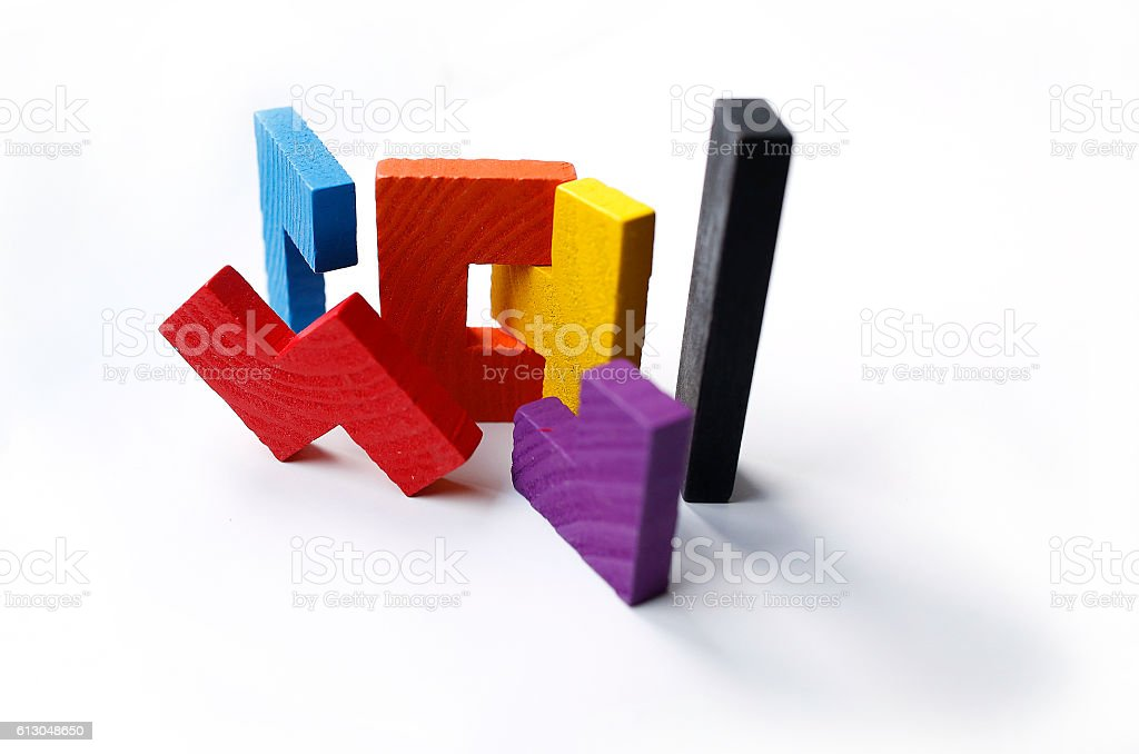 Colourful wooden puzzle blocks on white background stock photo