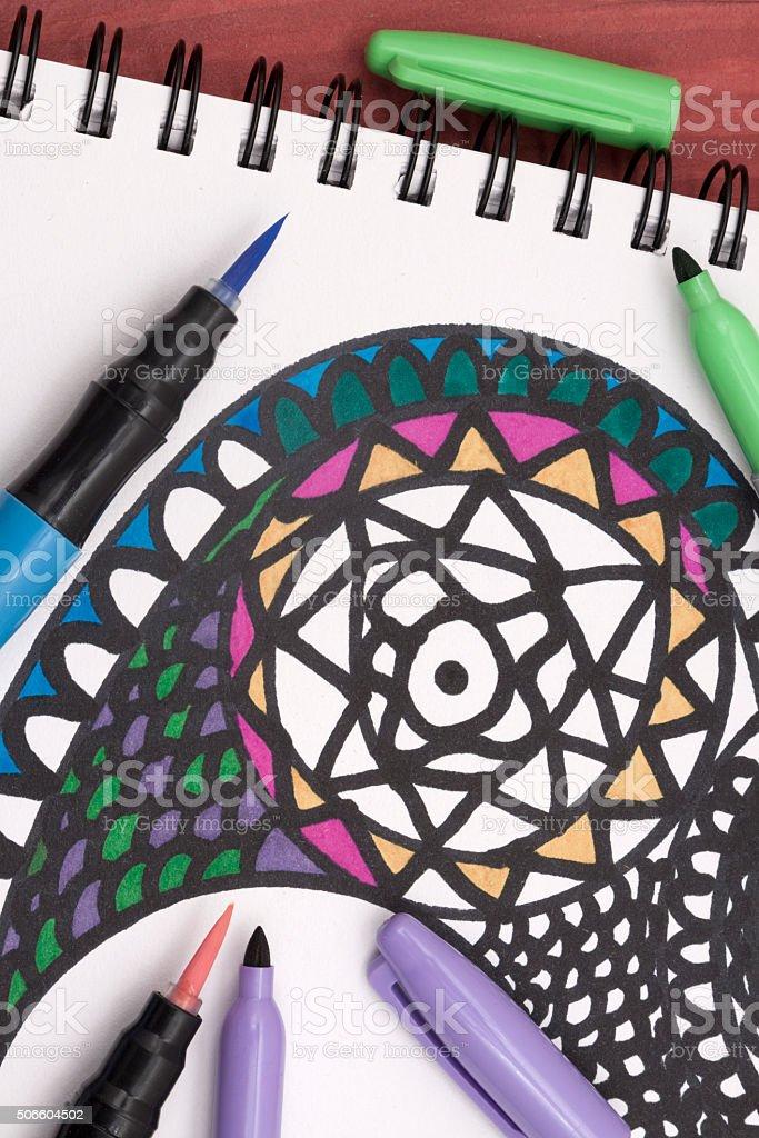 colouring a mandala stock photo