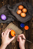hands on photo of the painting eggs for Easter