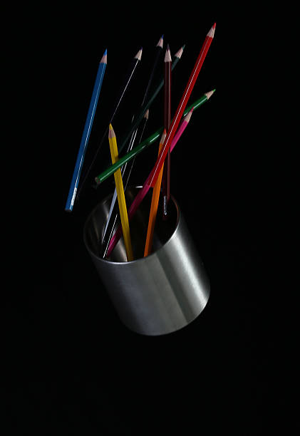 Colouring pencils in air falling out of the can stock photo
