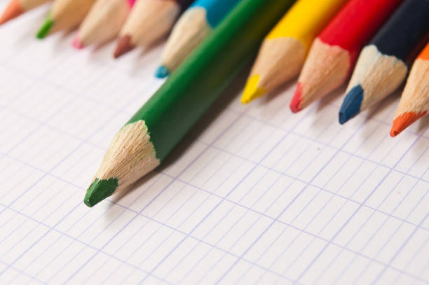 colouring pencils on notebook background stock photo