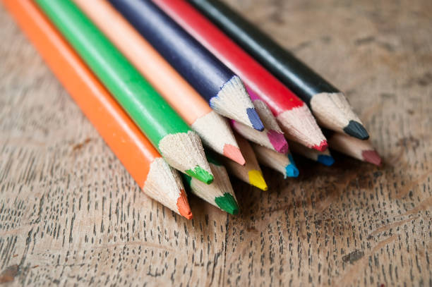 colouring pencils on wooden background stock photo