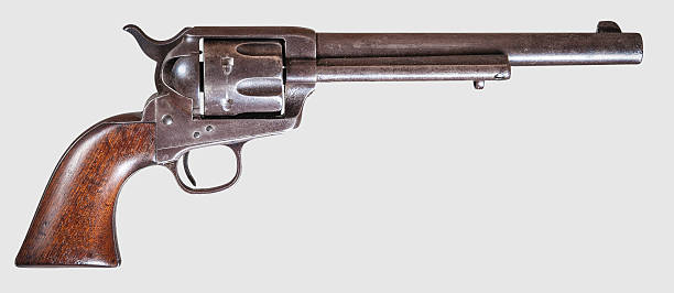 Colt '45 Single-Action Army Pistol, commonly known as the Colt .45 or the Peacemaker, on a white background and viewed from the right side.  The pistol was manufactured in the early 1880s and is in excellent condition. pistol stock pictures, royalty-free photos & images