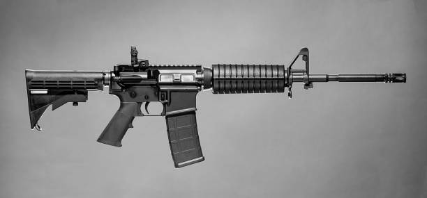 Colt AR-15 Rifle Colt AR-15 Rifle on a simple grey background. ar 15 stock pictures, royalty-free photos & images
