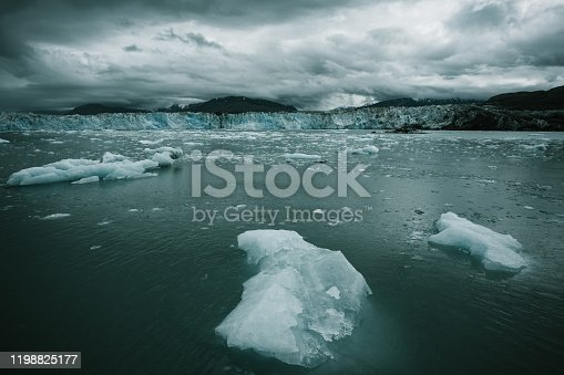 Columbia glacier, Alaska, passing through ice filled waters and mountains, United States of America